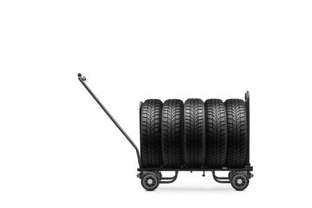 Studio shot of vehicle tires on a hand truck isolated on white background