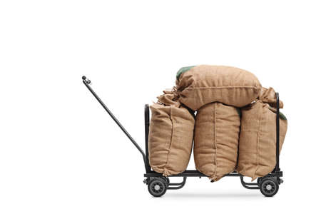 Side shot of burlap sacks on a hand truck isolated on white background