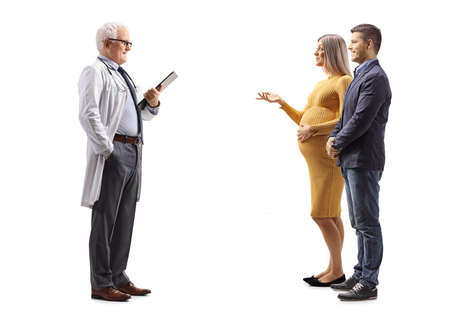 Full length profile shot of a young couple talking to a gynecologist isolated on white background