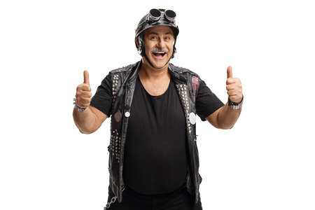 Mature man biker with a leather vest showing both thumbs up