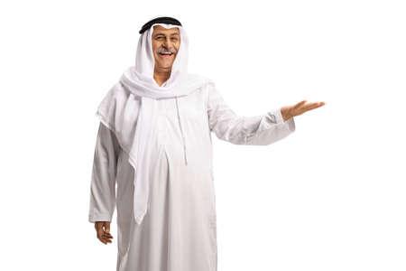 Mature muslim man in white dishdasha gesturing with hand Standard-Bild