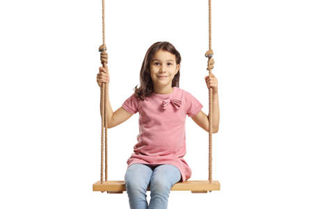 Girl sitting on a wooden swing isolated on white background