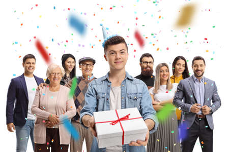 Guy with a present celebrating birthday with people behind isolated on white background