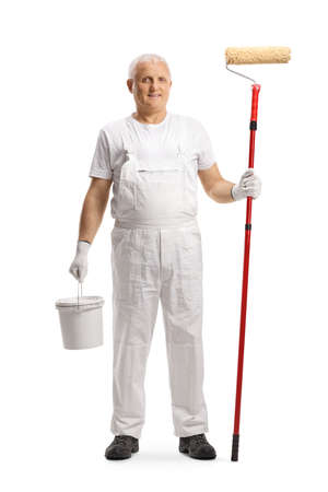Full length portrait of a mature house painter holding a bucket and a paint roller isolated on white background
