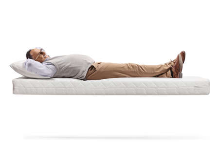Mature man lying on a floating mattress isolated on white background