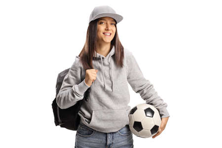 Female student holding a soccer ball isolated on white background Imagens