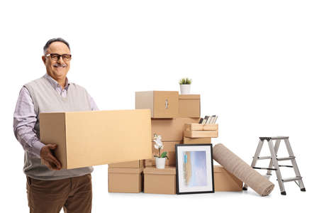 Smiling mature man packing for home removal and holding a cardboard box isolated on white background