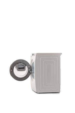 SIde shot of a washing machine with an open door isolated on white background