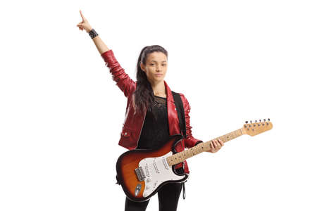Young female with a guitar standing and pointing up isolated on white background Imagens