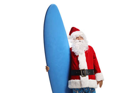 Santa wearing swimming suit and holding a surfing board isolated on white background
