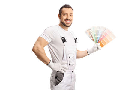 House decorator in a white uniform holding a color palette isolated on white background Imagens