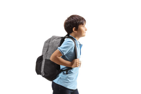 Profile shot of a schoolboy with a backpack isolated on white background Imagens