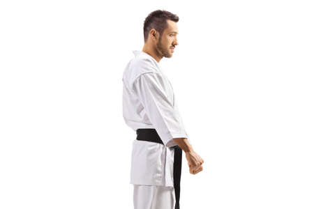 Young man in karate kimono with black belt isolated on white background