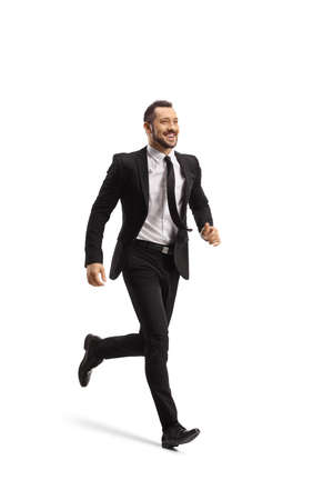 Full length shot of a happy businessman running and smiling isolated on white background Imagens