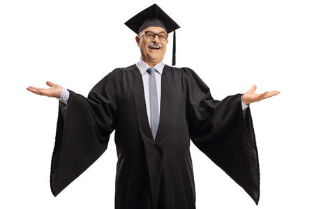 Cheerful mature man wearing a graduation gown and spreading arms isolated on white background Imagens