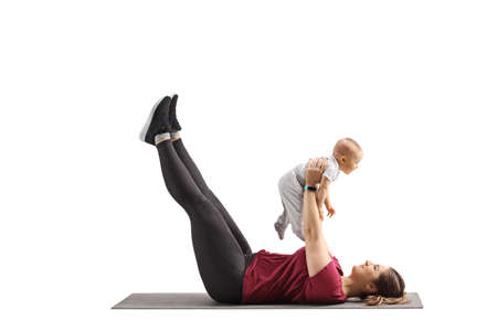 Mother exercising with her baby isolated on white background Imagens