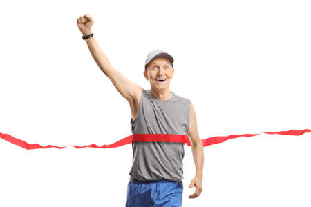 Elderly man on the finish of a marathon gesturing happiness with hand isolated on white background Imagens