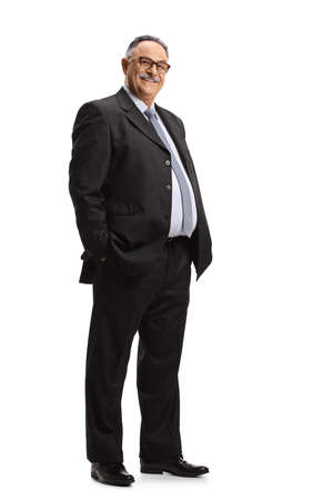 Full length portrait of a mature businessman posing with hands in pockets isolated on white background