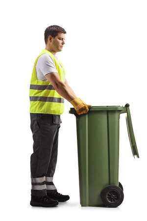 Full length profile shot of a waste collector with a green dustbin isolated on white background Imagens