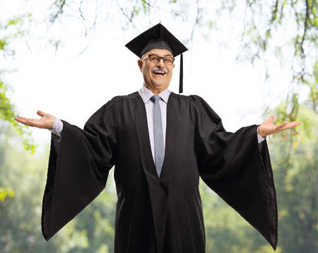 Elderly graduate smiling and gesturing with hands outdoors