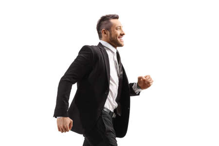 Young businessman in a black suit running and smiling isolated on white background