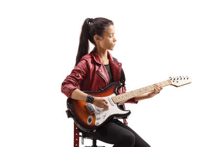 Female musician sitting and playing electric guitar isolated on white background