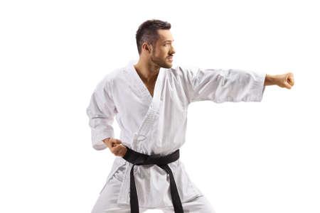 Man in kimono exercising karate isolated on white background