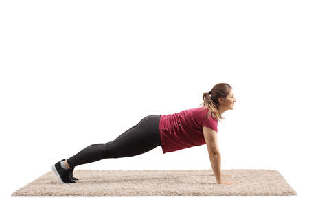 Young woman exercising plank exercise isolated on white background