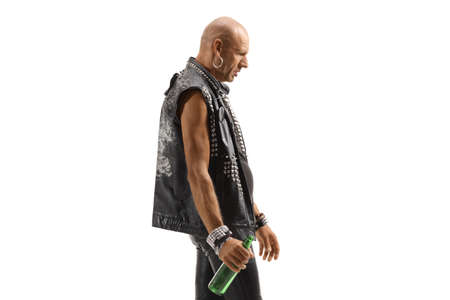 Punk walking and holding a bottle of beer isolated on white background