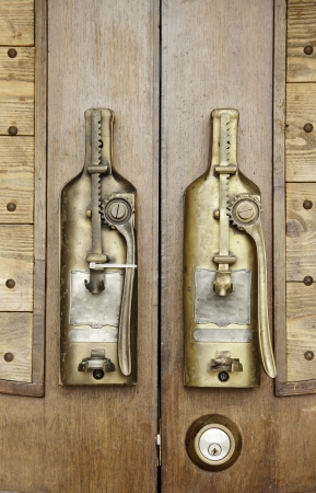 Old dopper door handle on wood door Stock Photo - 16750380