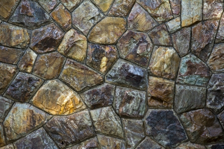 Wet round stone rock texture with tiny water drops  photo