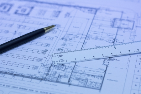 bluelines: pen, scale ruler and blueprint, building engineering concept, vertical orientation