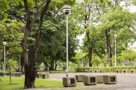 alfresco: Marble seat, pole lamp in park  Stock Photo