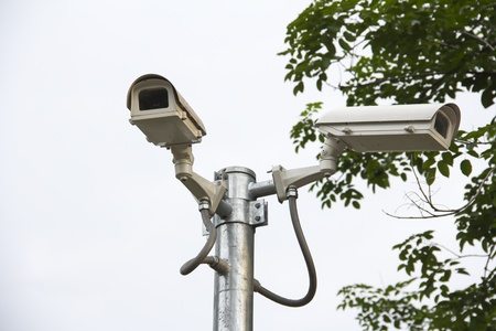 CCTV camera security on the road in the town photo
