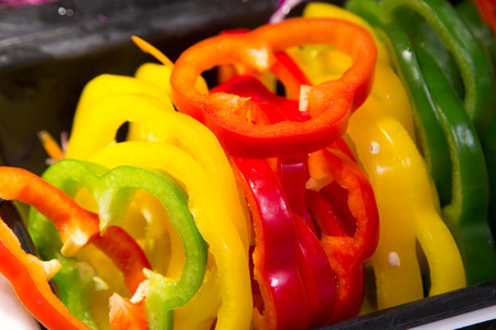 Green, yellow, red bell pepper slices.
