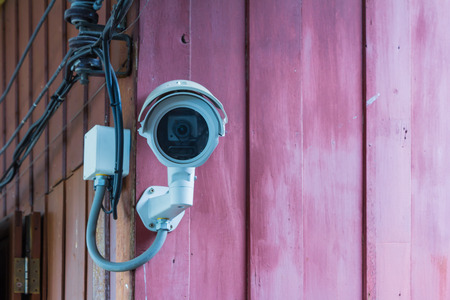 closed circuit television: CCTV surveillance camera on  wall background for safety concept.