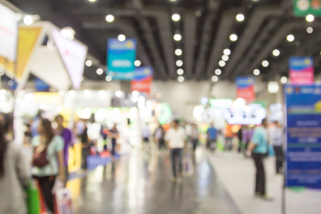 exhibitions: The blur of people in exhibition hall event.