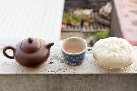 Chinese teapot and Chinese tea and dumplings streamed on the balcony., Chinese cuisine.