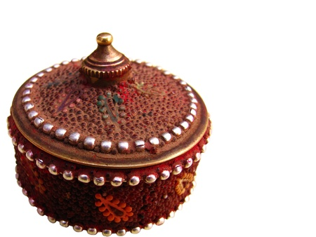 vermilion: an very old and antique box used to store vermilion which is a traditional red or orange-red colored cosmetic powder from the Indian subcontinent, usually worn by married women along the parting of their hair