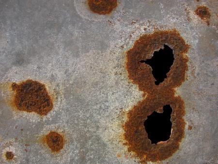 worn rusted metallic sheet photo