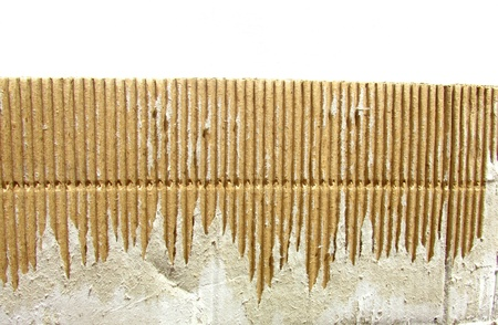 ribbed: Image of torn cardboard piece isolated on white