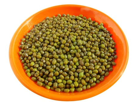 Mung beans (Vigna Radiata) also called green gram or golden gram, isolated on white background photo