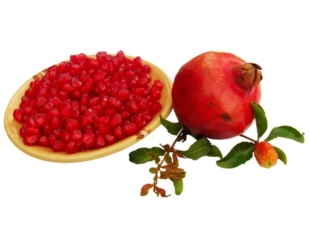 punica granatum: pomegranate  Punica granatum  fruit with seeds Stock Photo