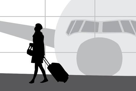 Vrouw lopen in de luchthaven Sihouette