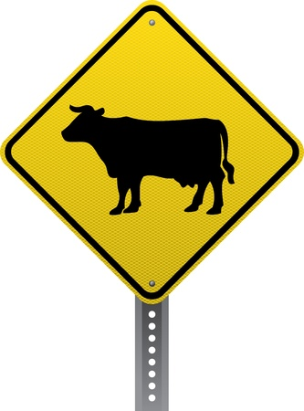 road conditions: Cattle crossing traffic warning sign. Diamond-shaped traffic signs warn drivers of upcoming road conditions and hazards.