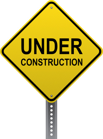 road conditions: Under construction sign. Diamond-shaped traffic signs warn drivers of upcoming road conditions and hazards. Stock Photo