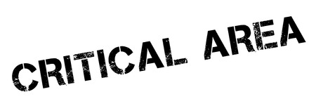 crucial: Critical Area black rubber stamp on white. Print, impress, overprint. Illustration