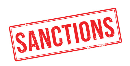 sanctioned: Sanctions red rubber stamp on white. Print, impress, overprint.