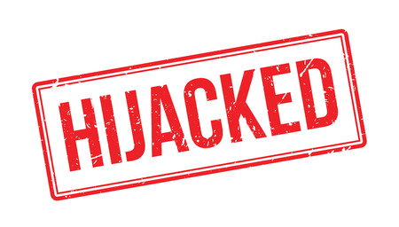 hijack: Hijacked rubber stamp on white. Print, impress, overprint. Terrorism emergency label. Airplane security fail. Sign of plane stolen with hostages taken. Serious airline security accident.