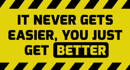 strong message: It never gets easier sign yellow with stripes, road sign variation. Bright vivid sign with warning message.